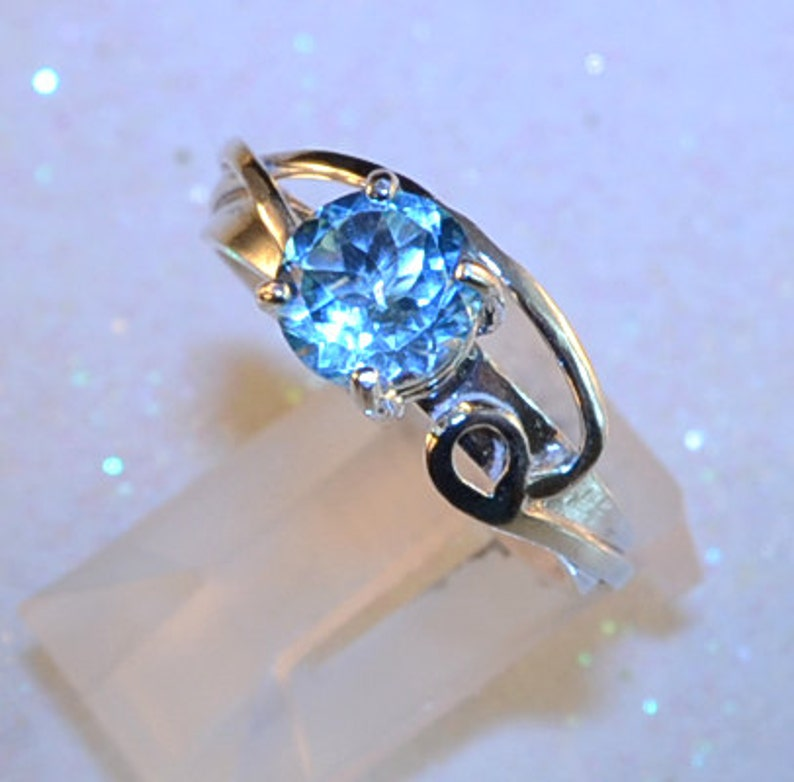 Floating  Blue Topaz gemstone ring image 0