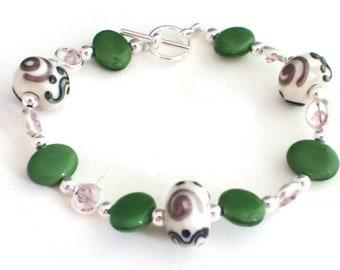 Green Czech Glass Oval Beads, Lilac Swarovski Crystals with Lampwork Swirl Silver Bracelet