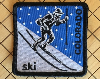 Ski Colorado - square embroidered iron-on patch featuring telemark skiing