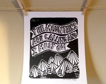 MOUNTAINS ARE CALLING - linocut print on white paper with mountains and text