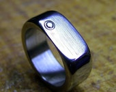 Size 7-Titanium and Diamond Ring (with gold bezel)