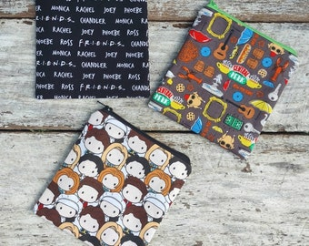 Friends themed square zipper pouches. The one with the names. The one with the faces. The one with the icons. Fabric change purse. Gift idea