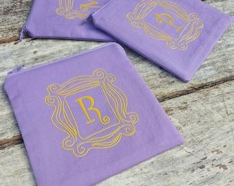 The one with the monogram zipper pouch. Gift idea. Friends door. Monica, Rachel, Phoebe.