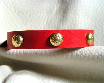 Scarlet and brass harness cuff