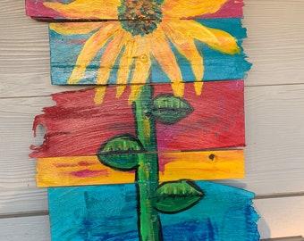 RhondaK Coastal Art on Driftwood Like Wood With Yellow sunflowers on tropical beach happy colors