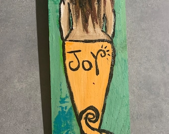 RhondaK Handpainted blond Mermaid on Driftwood like Wood in pastels of green and peach with saying JOY
