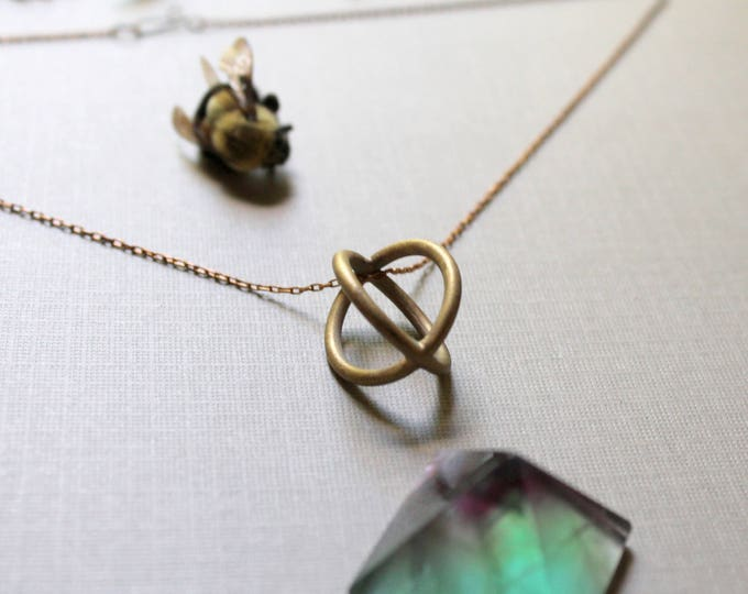 Trapped // round brass cage necklace