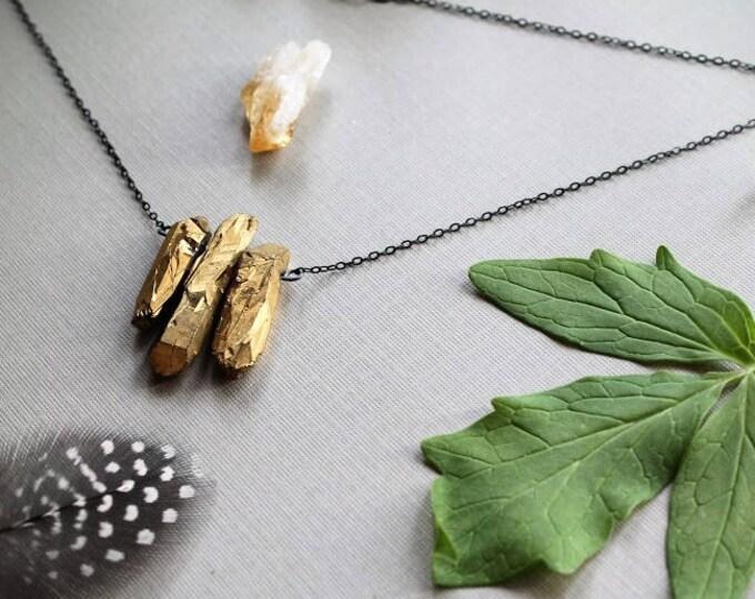 The Midas Touch // gold quartz point necklace