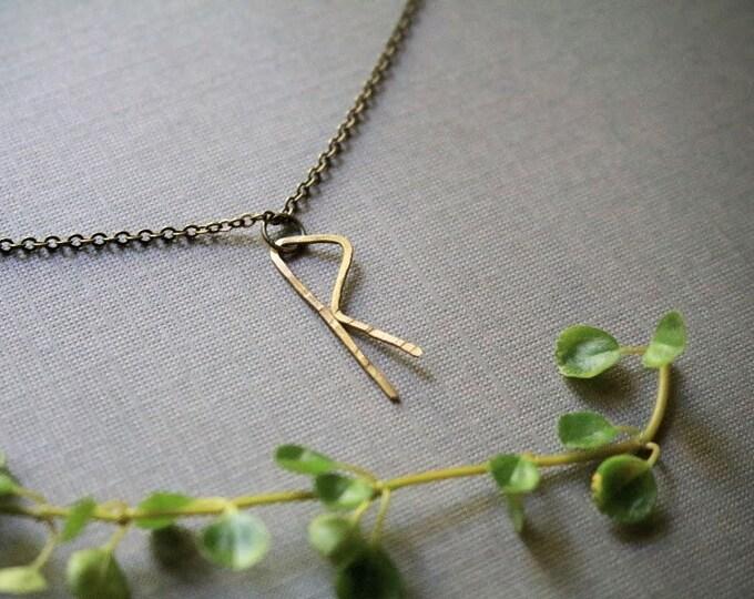Journey // rune necklace in brass