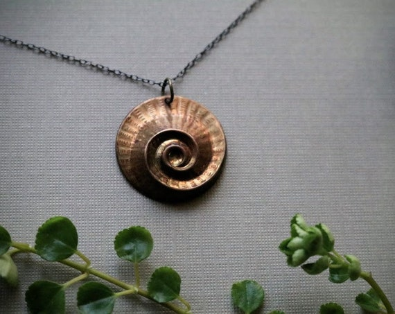 Nautilus // vintage brass spiral necklace