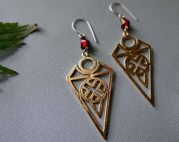 Smolder // golden geometric charm and glowing red crystal earrings