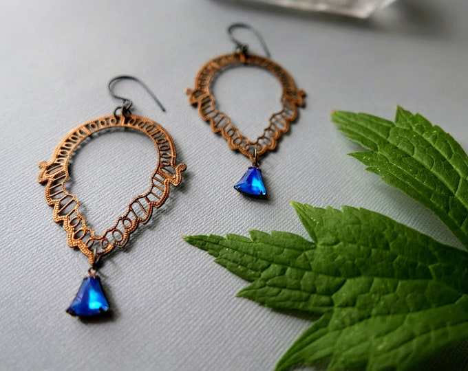 Vision Quest // large filigree earrings with a glowing blue crystal