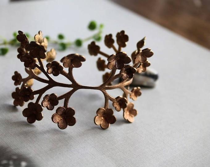 May Flower // vintage raw brass flower bracelet