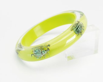 Chartreuse lucite braeelet with real metallic beetles