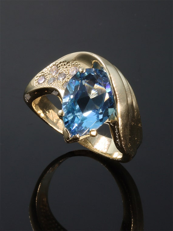 14K Gold Ring with Blue Topaz and Diamonds by Cavallo Fine Jewelry