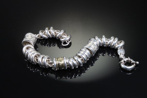 Vintage sterling silver and 18K yellow gold heavy link and donut bead bracelet, intriguing, exotic wrist candy statement jewelry