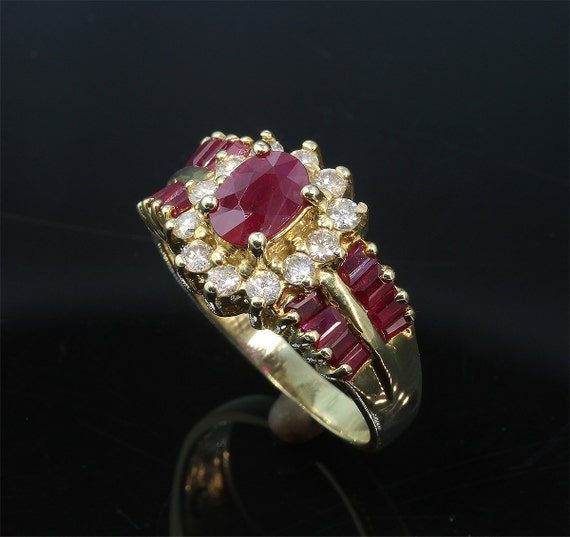 14K Yellow Gold Vintage Ring with Oval Ruby, Ruby Baguettes and Diamond Halo