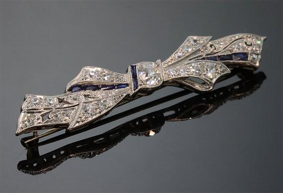 Antique Platinum, Diamond and Blue Sapphire Art Nouveau Era Ribbon Brooch