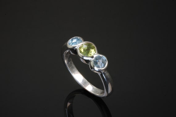 Sterling Silver Infinity Ring with Peridot and Blue Topazes