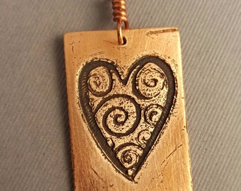 Copper Spirals within an etched Heart Pendant