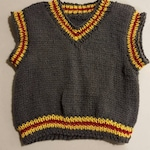 Reserved for adventurejac - Hand knit baby vest