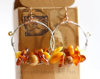 Amber - Strung-Out guitar string steel wound hoop earrings with amber and fossil coral