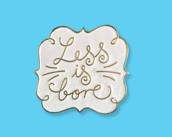 Less is bore - lapel pin