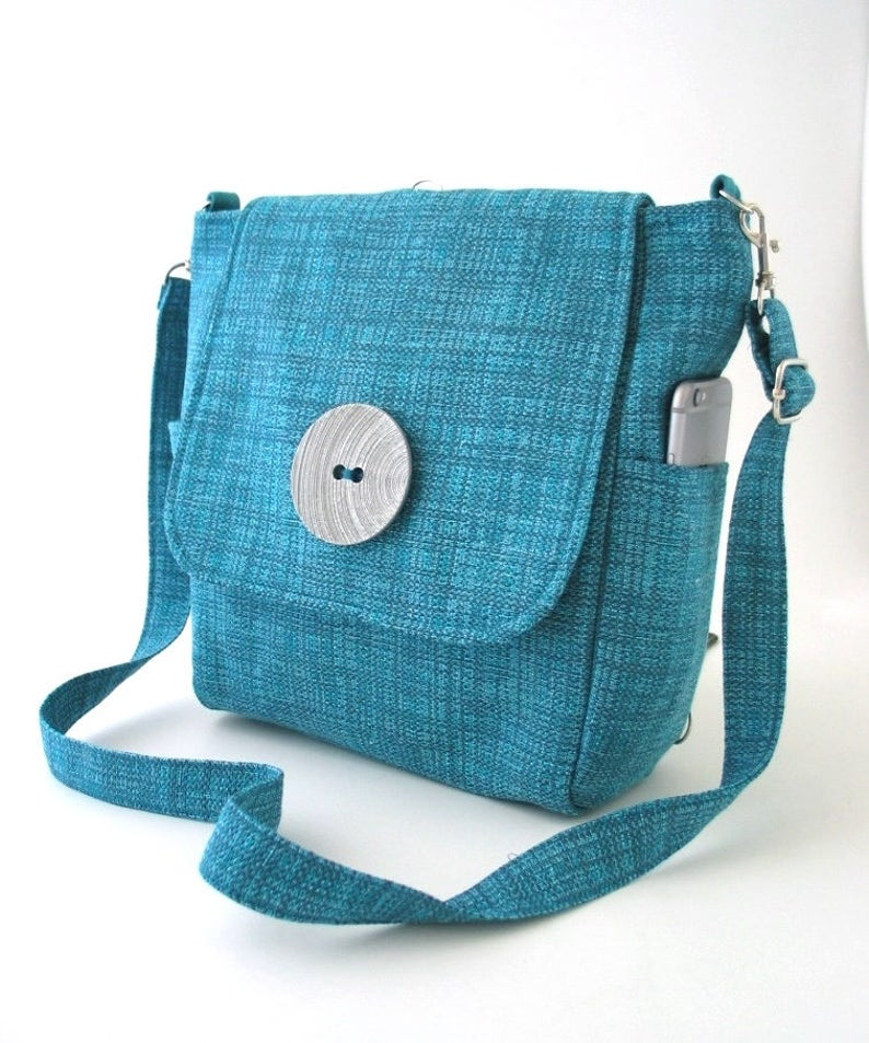 blue backpack bag converts to messenger bag womens backpack image 0