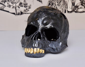 memento more  skull with gold teeth