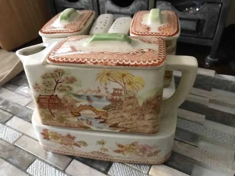 Chinese Teapot set sugar creamer pepper shakers on warming trivet