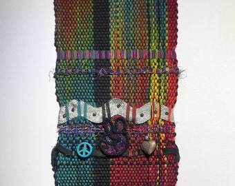 """Hand Woven Hand Dyed Tussah Silk Tapestry in Multicolors Needle Woven Peace Sign, Brass Locket, Rick Rack 6"""" x 18"""""""