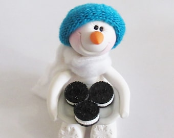 Snowman ornament and favorite cookies plate of oreo sandwich cookies, polymer clay snowman