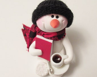 Snowman ornament: A good book and a cup of coffee are all I need. Snowman decoration polymer clay