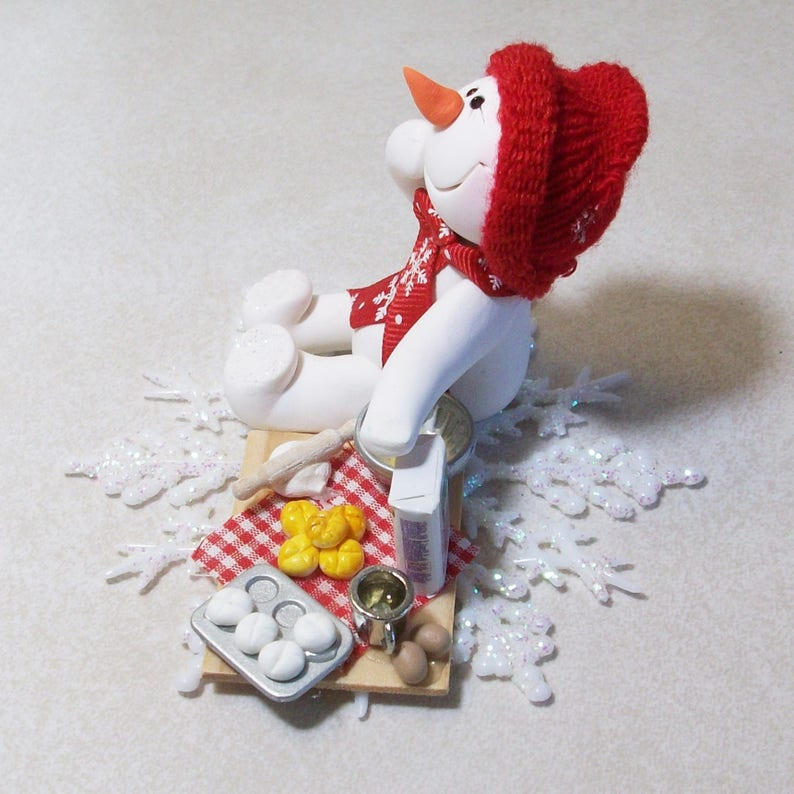 Ready to do some baking Snowman ornament with snowflake base polymer clay snowman