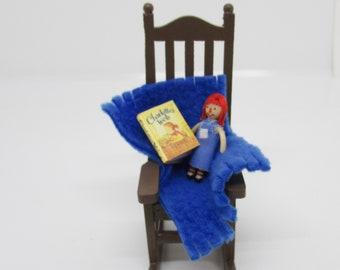 Miniature book, wood rocking chair and Raggedy Ann doll