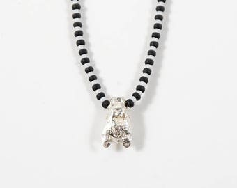 Sterling silver honey bee pendant on glass beaded necklace