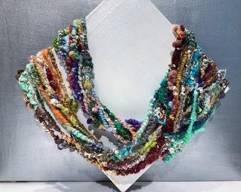 "Core-spun, Boucle Art Yarn, Handspun ""Penny Candy"" 5.1 oz, 22 yards multicolor w/ white, super bulky"