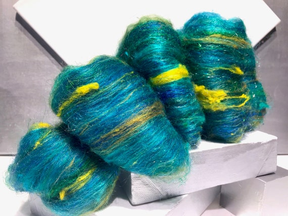 "Fiber art batt, spinning fiber ""Traipsing through the Daffodils"" yellow, green, turquoise, sky blue, cobalt with pops of purple"