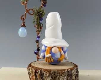 Illustration in Glass Gnomes in a rainbow of hats on white handmade lampwork glass bead focal by JC Herrell