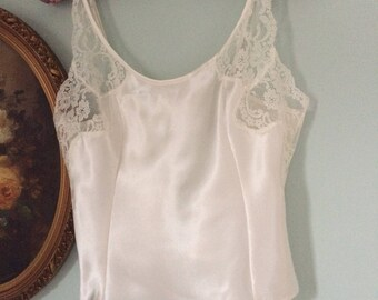 Vintage Victoria's Secret white satin and lace trimmed camisole. Sz large.