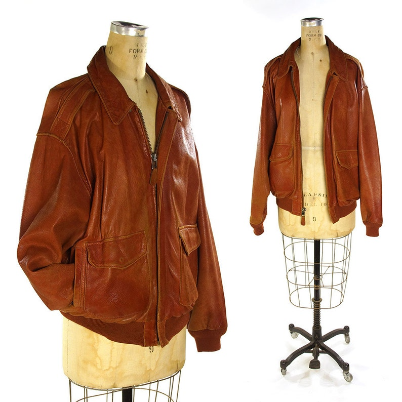4f95c5002 Leather Bomber Jacket Vintage 80s Avirex A-2 Aviator Flight Jacket Faded  Distressed Brown US Army Air Force Military Map Lining 52