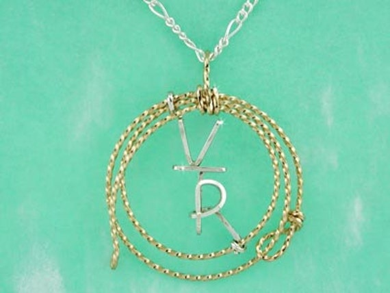 Your Brand in Sterling Silver & Surrounded by a Hand Made Lariat in 12 Karat Gold Wire