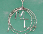 Your Brand Surrounded by a Hand Made Lariat in Sterling Silver