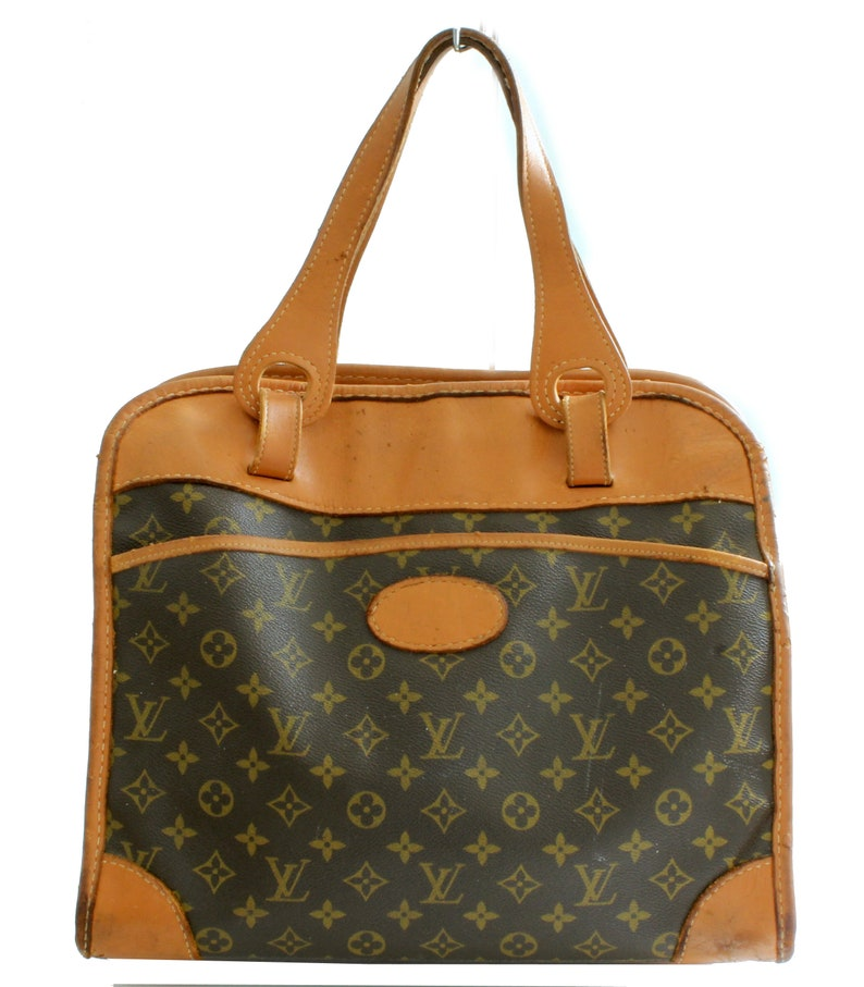 df2792cf8f34 Louis Vuitton The French Company Carry On Monogram Canvas Tote