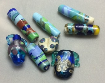 Lampwork Orphans 8 beads  - 5 tubes, 2 mini vessels, 1 heart