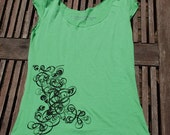 Silkscreened shirt Decorative Swirl black on green