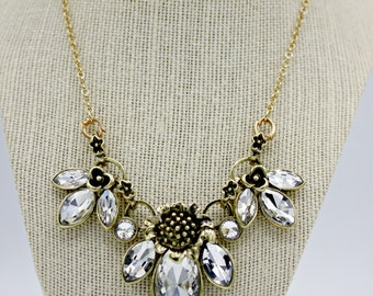 """Trio of Bling with brass and crystal on 16"""" gold plated chain"""