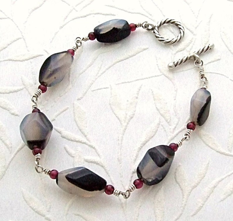 Black and White Onyx Bracelet with Garnets in Silver Black image 0