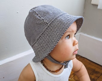 07fa6fbe Striped Denim Summer Sun Hat for Baby Boys and Girls. Bucket Hat with Chin  Straps