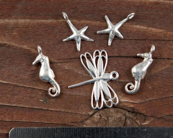 Lot of FIVE Sterling Silver Charms